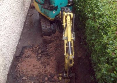 Mini digger trench